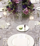 Wedding reception centerpiece of purple flowers