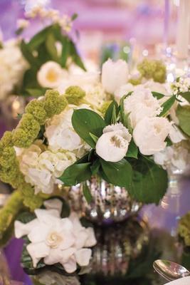 white ruffled edge tulips and hydrangeas in mercury vases
