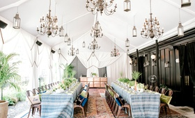 rooftop bridal shower nomad hotel new york blue white linens personalized pillows drapery lanterns