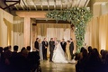 Simple wedding ceremony decor with wooden arch greenery on one side