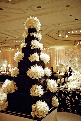 Black wedding cake with white sugar orchids