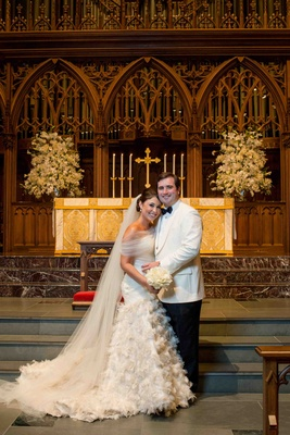 Bride and groom at church ceremony altar