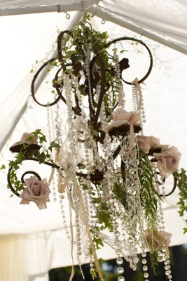 Crystals and pearls hanging from wedding canopy