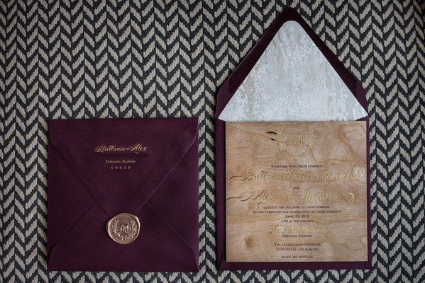 burgundy oxblood wedding invitation envelope with gold seal and wood grain gold calligraphy invite
