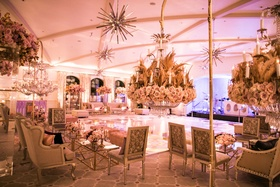 Wedding after party dance floor lounge areas around dance floor starburst lighting flower chandelier