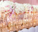white hydrangeas, white and blush roses, white orchids, pink orchids on king's table