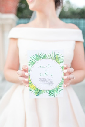 The Confused Millenial wedding shoot invitation green palm print white manicure off shoulder gown