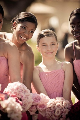 Teenage bridesmaids in pink dresses with pink bouquets