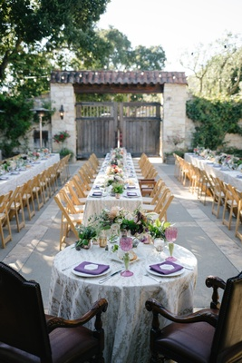 Elegant dark plum chairs at sweetheart table  purple napkins low centerpieces outdoor wedding