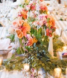 peach and pink flowers and greenery down center of table