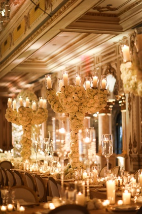 oversized wedding flower centerpiece candelabra rose and hydrangea white gold decor candlelight