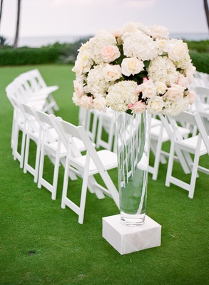 Clear vase topped with ivory flower arrangement