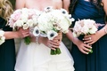 Bridal bouquet of ivory hydrangreas, roses, peonies, and anemones with dark blue centers