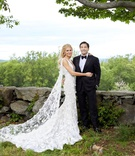 wedding portrait bride and groom photo bride in marchesa wedding dress with cape groom in tuxedo