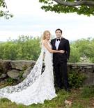 wedding portrait bride and groom photo bride in marchesa wedding dress with cape groom in tuxedo