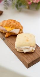 Ham & cheese sandwich on a croissant, turkey & Brie on ciabatta for outdoor wedding shower