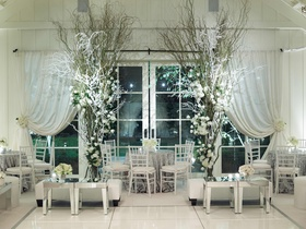 Silver tablecloths, snow-covered trees, and mirrors