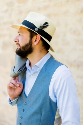 groom in casual suit blue vest button up shirt panama fedora italian destination wedding attire