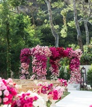 wedding ceremony pink flower chuppah and white aisle runner backyard wedding ceremony