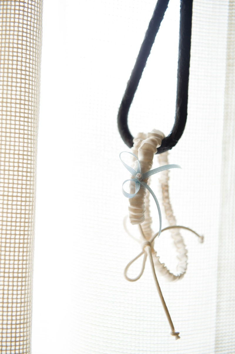 skinny white garter with corded tie and light blue bow