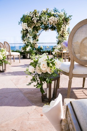 Wedding ceremony decor rustic chair french style lantern with roses greenery arch ocean view