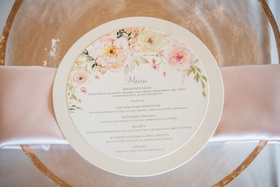 wedding reception menu with floral details and a circle shape