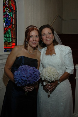 Twin bride and bridesmaid at church ceremony