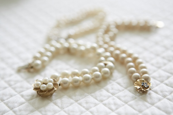 Double row of pearls with gold floral clasp