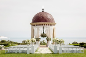 the resort at pelican hill wedding under a rotunda with floral chandelier, newport wedding