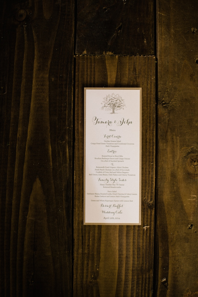White menu card with tan border on wood planks