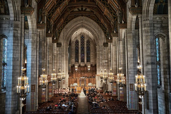 Wedding ceremony at Fourth Presbyterian Church with high ceilings, stone columns, exposed butresses