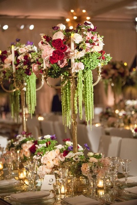 Wedding reception tall centerpiece with candelabra amaranthus red flowers rose tulip peony anemone