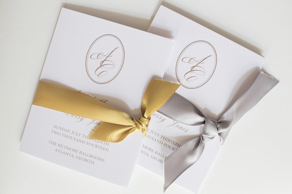 Wedding ceremony programs with monogram and gold silver ribbon
