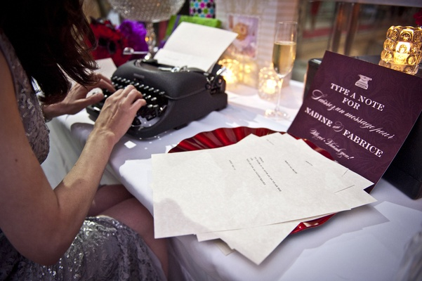 typewriter as wedding guest book, guest types message to newlyweds on typewriter