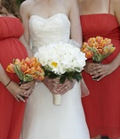 Orange tulip bridesmaid flowers and white bridal bouquet