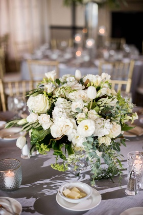 small white and green centerpieces with roses, tulips, eucalyptus