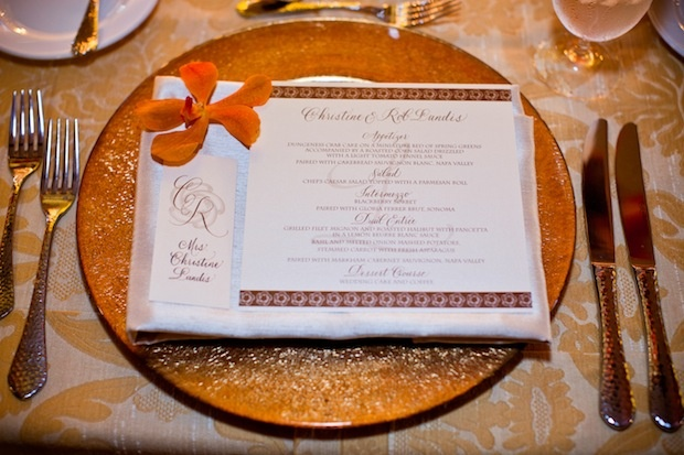 Gold charger plate and motif-bordered menu