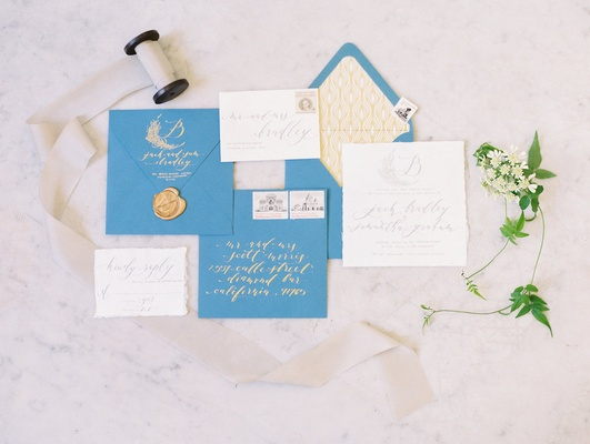 Seniman Calligraphy wedding invitation suite with blue envelopes, gold lining, seal, calligraphy