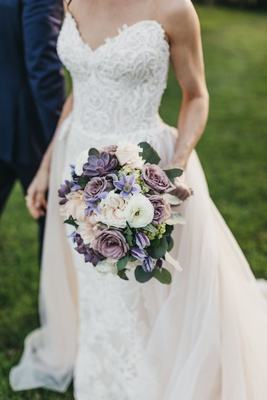 bridal bouquet with dusty purple roses and succulents with pale blush and ivory flowers