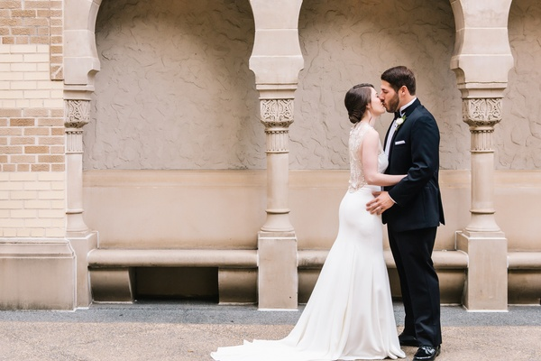 bride in lela rose wedding dress, groom in michael kors tuxedo, kiss, first look