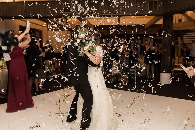 bride and groom showered with confetti during the first dance