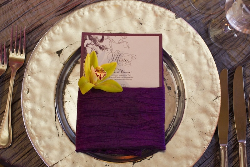 Wedding place setting with lime green cymbidium orchid and menu