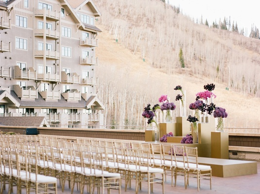 Wedding ceremony outdoors at Montage Deer Valley looking at mountain grounds purple flowers gold