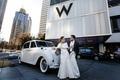 Bride with fur bolero in front of W hotel in Atlanta
