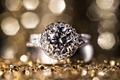 Platinum white gold diamond engagement ring with halo setting