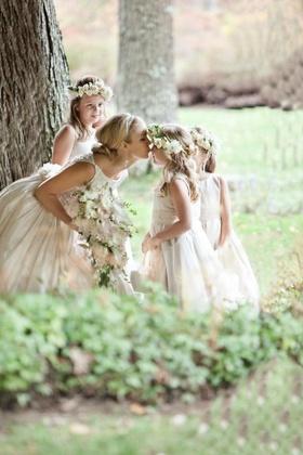 Keri Lynn Pratt kisses flower girls' nose in forest