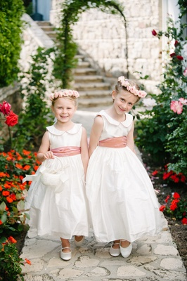 flower girls in white dresses with peter pan collars, blush sashes, pink rose flower crowns
