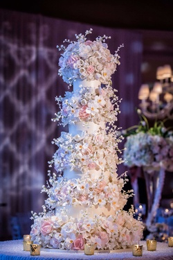 Sylvia Weinstock wedding cake at reception at The Breakers fifty inches high sugar flowers peony