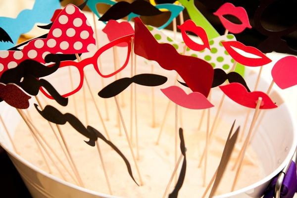Sunglasses, bow ties, and lips on skewers