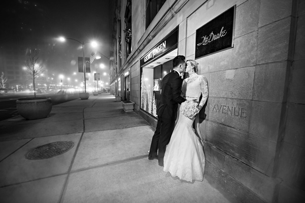 rob refsnyder of new york yankees, bride and groom kiss outside the drake hotel, chicago wedding